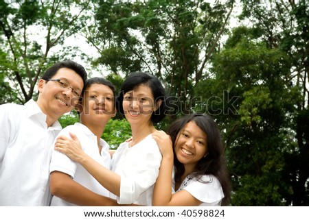 happy asian family posing together outdoor