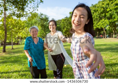 Happy asian family time together outdoor in nature,little child girl or granddaughter play,fun,smile with adult mother, senior grandmother with walker in park,harmony in family life,love,care concept #1436506730