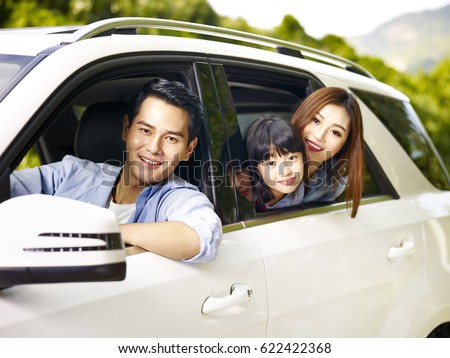happy asian family traveling by car looking at camera smiling. ストックフォト ©