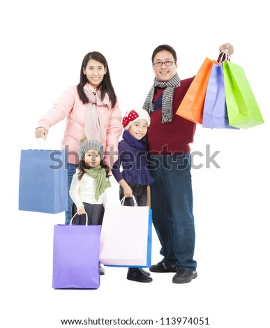 happy asian family with shopping bag in winter clothing - stock photo