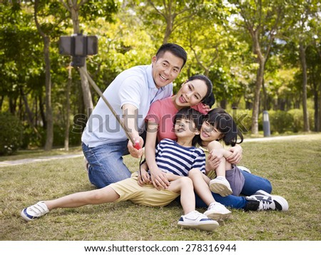 happy asian family with two...