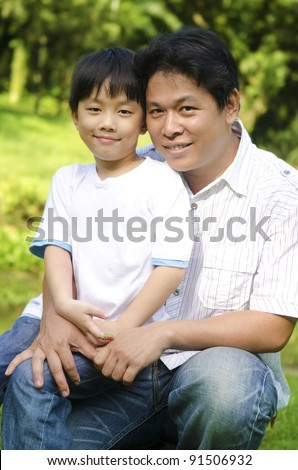 Happy Asian father and son