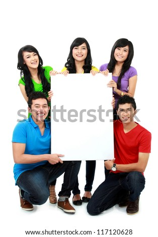 happy asian group of young people hold blank poster