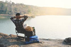 Happy Asian hipster man backpack in nature background, Relax time on holiday concept travel , color of vintage tone and soft focus