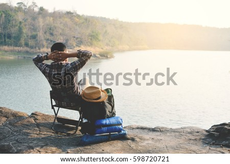 Happy Asian hipster man backpack in nature background, Relax time on holiday concept travel , color of vintage tone and soft focus Stock fotó ©