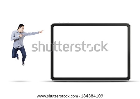Happy asian man pointing at empty board, isolated on white background