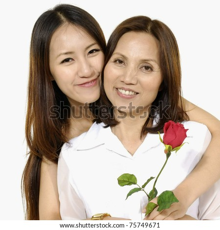 Happy Asian Mother and Daughter with red rose