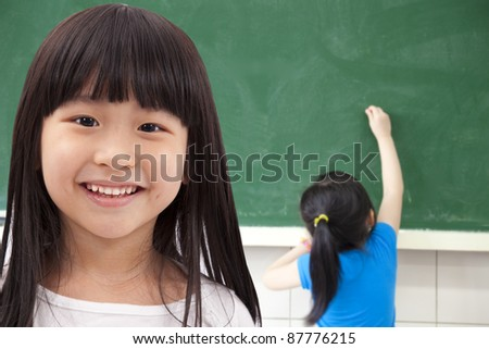 happy asian student girls at school classroom