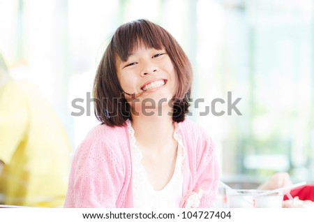 Happy Asian Teenager girl laughing