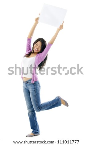 Happy Asian woman holding blank sign above her head. Full length on white background.