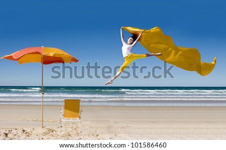 Happy asian woman jumping at tropical beach