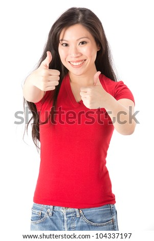 Happy Asian woman with both thumbs up in approval. Isolated on white background.