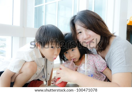 Happy Asian woman with her son and daughter