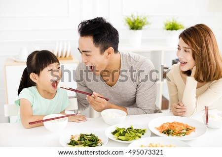 happy asian young Family enjoy their lunch