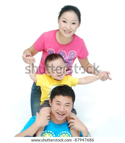 Happy Asian young family with cute child