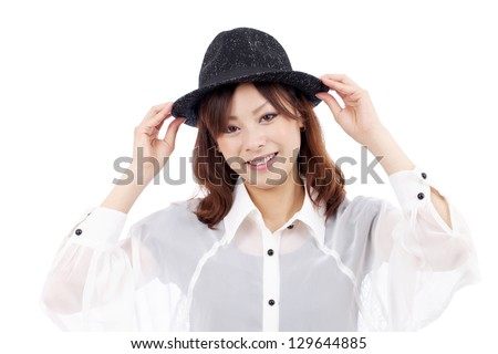 Happy asian young girl wearing hat, smiling, looking at camera, on white background
