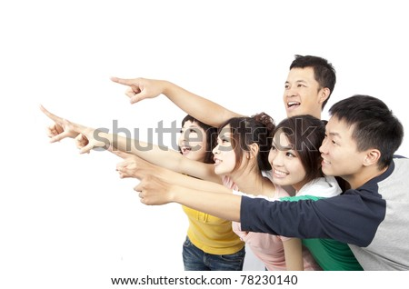 happy Asian young group pointing away isolated on white background