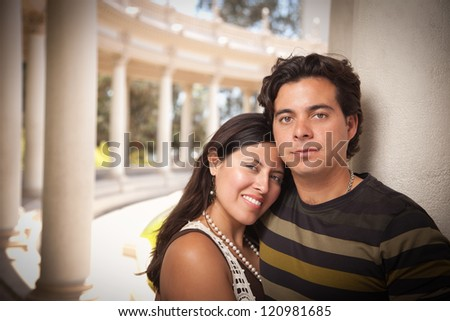 Happy Attractive Hispanic Couple Enjoying Themselves At The Park.