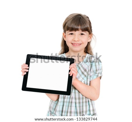 Happy attractive little girl holding a blank tablet up in her hands so that the blank screen with white copyspace is displayed towards the camera. Isolated on white.