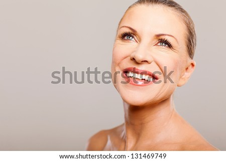 happy attractive middle aged woman looking up and smiling