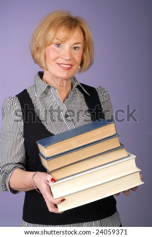 happy attractive older lady holding stack of books