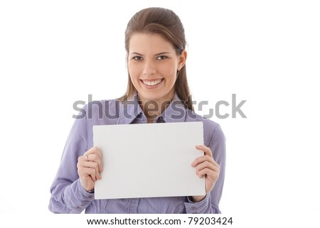 Happy attractive woman with blank sheet handheld, smiling at camera, blank space.?