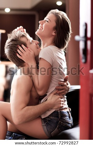 happy attractive young adults hugs each other