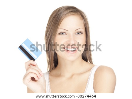 happy attractive young woman holds credit card