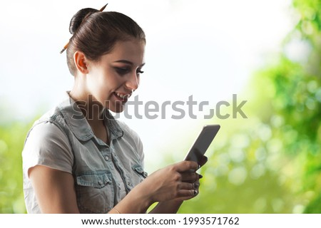 Happy attractive young woman using smart phone