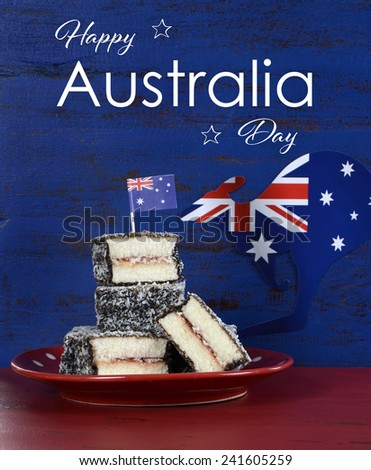 Happy Australia Day January 26 party food with iconic Australian lamington cakes on dark red and blue vintage rustic recycled wood background, with sample text.