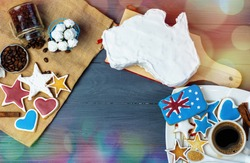 Happy Australia Day message greeting card - vanilla cream cake and patriotic sweets in a shape of the Australia
