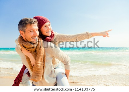 happy autumn fall couple showing with outstretched arms