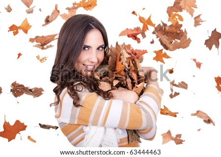 happy autumn woman with falling leaves in background