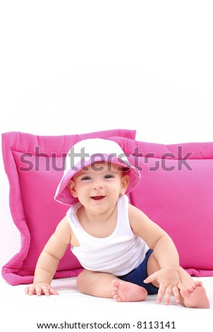 Happy Baby and two pink pillows on white .