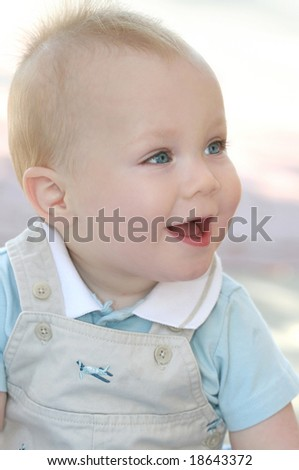 Happy baby boy, laughing and smiling