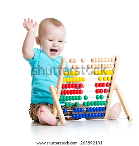 Happy baby boy playing with counter toy