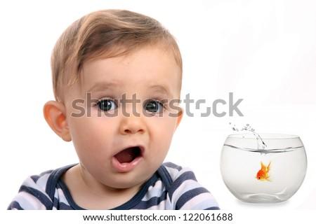 happy baby boy with fish in aquarium