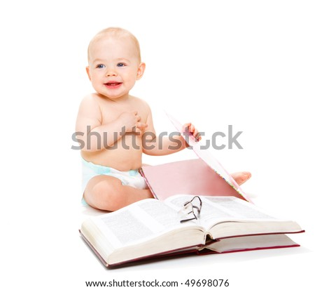 Happy baby boy with open books and glasses on them