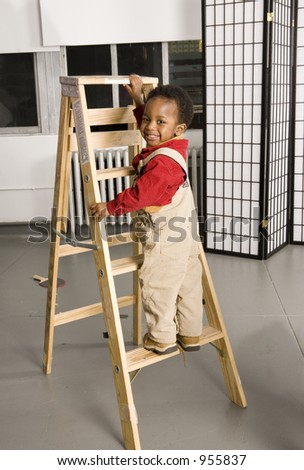 Happy baby climbing a ladder