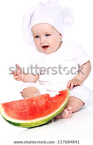 Happy Baby cook eating watermelon isolated on a white