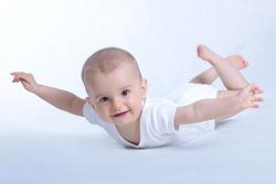 Happy baby flying on white