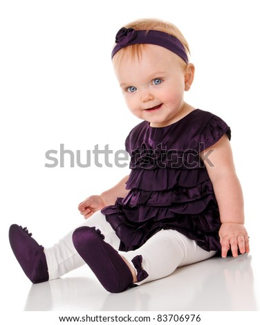 Happy Baby Girl in purple dress