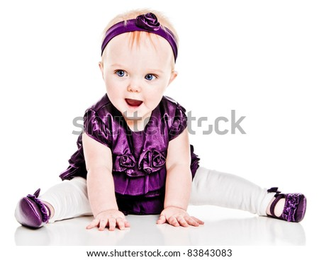 Happy Baby Girl in purple dress - stock photo