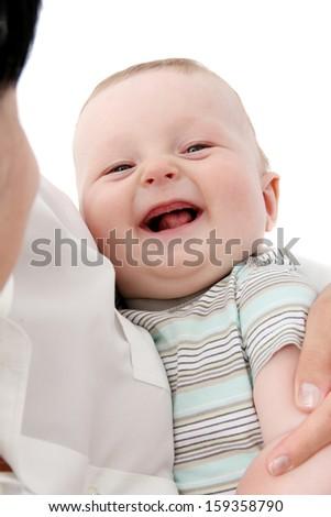 Happy baby in mother's hands