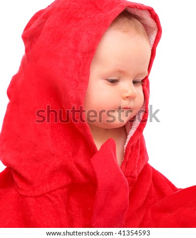 Happy baby in red towel - stock photo