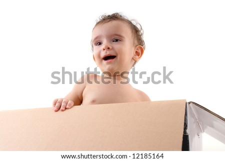Happy Baby inside of a cardboard box .