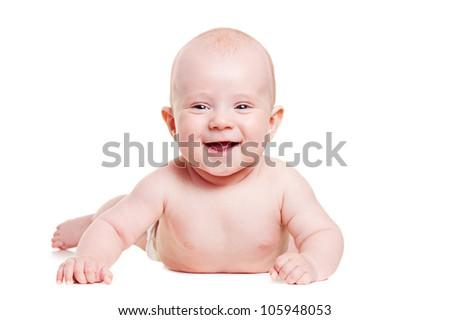 happy baby lying on white floor