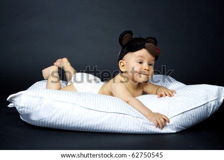 happy baby on pillow