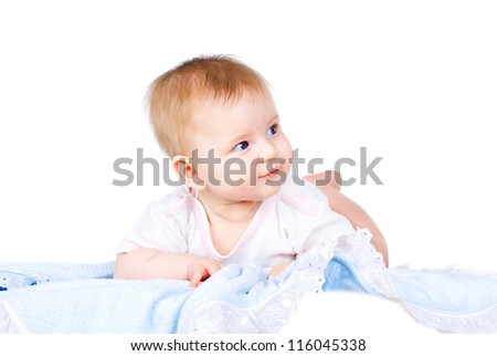Happy Baby on the diaper lying isolated on a white background