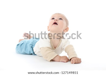 Happy baby on white background looking up, isolated, tummy time